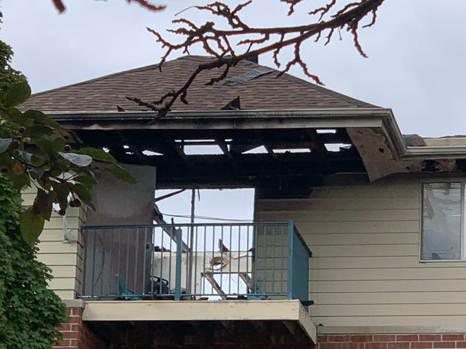 The sky is in full view through the patio doors of an apartment balcony at the Hillcrest Apartments building in Waukesha that was severely damaged by a Sept. 12 fire. A lightning strike led to a fire that destroyed most of the building's roof.