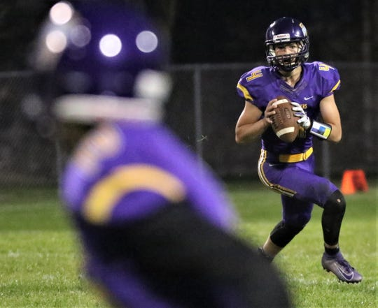 Racine Lutheran quarterback Nolan Kraus keeps his eyes downfield on a rollout against Martin Luther on Sept. 12, 2019.