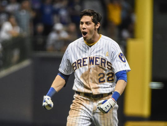 Sep 7, 2019; Milwaukee, WI, USA; Milwaukee Brewers right fielder Christian Yelich (22) reacts after hitting a double to drive in the winning run to help beat the Chicago Cubs at Miller Park. Mandatory Credit: Benny Sieu-USA TODAY Sports