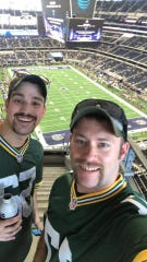 Oshkosh natives Kevin Speigl (left) and Mike Frost pose from their seats at AT&T Stadium in Dallas on Oct. 8, 2017.