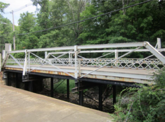 Openaki Road Bridge crosses Den Brook at Openaki Lake