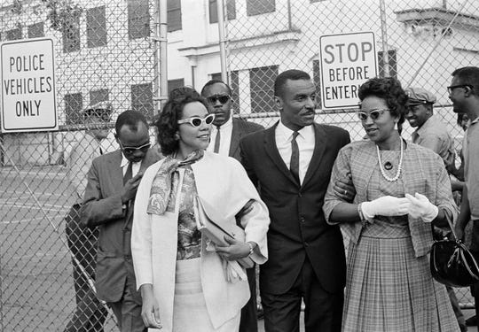 FILE - In this April 18, 1963 file photo, Coretta Scott King, left, the Rev. Fred L. Shuttlesworth, center, and Mrs. Juanita Abernathy, leave Birmingham jail after visiting Rev. Martin Luther King, Jr. and Rev. Dr. Ralph Abernathy in Birmingham, Ala. Juanita Abernathy, who wrote the business plan for the 1955 Montgomery Bus Boycott and took other influential steps in helping to build the American civil rights movement, has died. She was 88. Family spokesman James Peterson confirmed Abernathy died Thursday, Sept. 12, 2019, at Piedmont Hospital in Atlanta following complications from a stroke. (AP Photo/File)