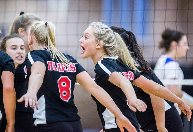 FILE -- Wapahani volleyball celebrates after a point against Burris at Burris High School Thursday, Sept. 12, 2019.