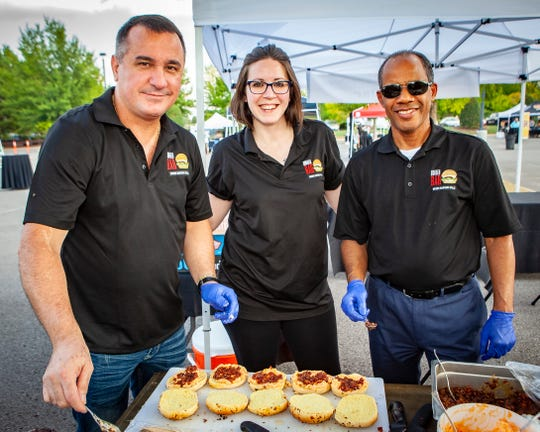 Standing with the Burger Bar's first-place winning burger, the Southern Jam,  at the 2019 Battle of the Burger are, from left, Gino Brito, Holly Kirk and Gerardo Guerrero.