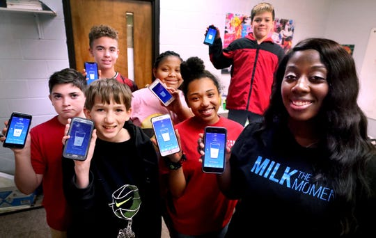 "Courtney ""Coko"" Eason shows off her Milk the Moment app with some of the kids using it from the Boys & Girls Clubs of Rutherford County on Thursday, Sept. 12, 2019."