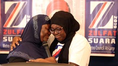 Zulfat Suara, winner of an at-large Metro Council seat, left, gets a hug from her daughter Safiyah Suara before her speech at her watch party Thursday, Sept. 12, 2019, in Nashville.