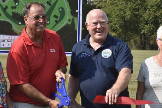 "Disc Golf Course Senior Designer HB Clark and Ashland City Mayor Steve Allen cut the ribbon at the new disc golf course at the John C. ""Preacher"" Poole walking track."