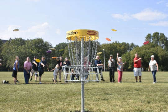"Ashland City officials and Kentucky-based Disc Golf Course Senior Designer HB Clark try out the new disc golf course, around the John C. ""Preacher"" Poole walking track."