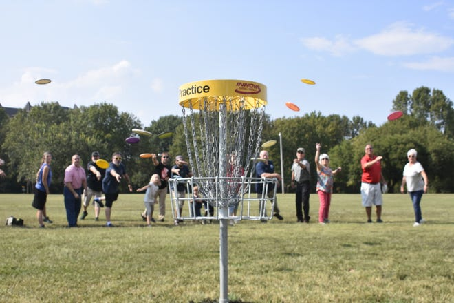 """Ashland City officials and Kentucky-based Disc Golf Course Senior Designer HB Clark try out the new disc golf course, around the John C. """"Preacher"""" Poole walking track."""
