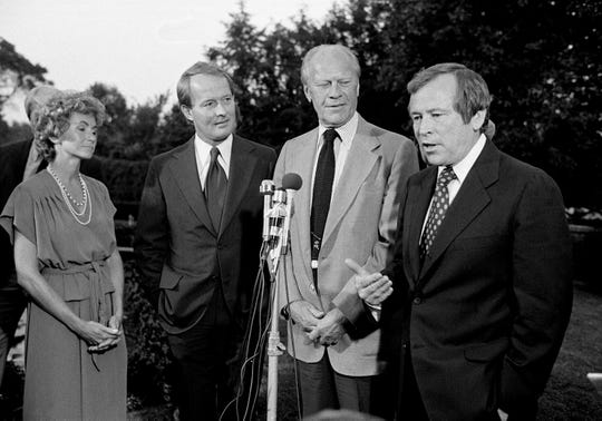 Senate Minority Leader Howard Baker, right, talks about presidential politics in front of the governor's mansion Sept. 29, 1979, with Honey and Gov. Lamar Alexander and former President Gerald Ford.