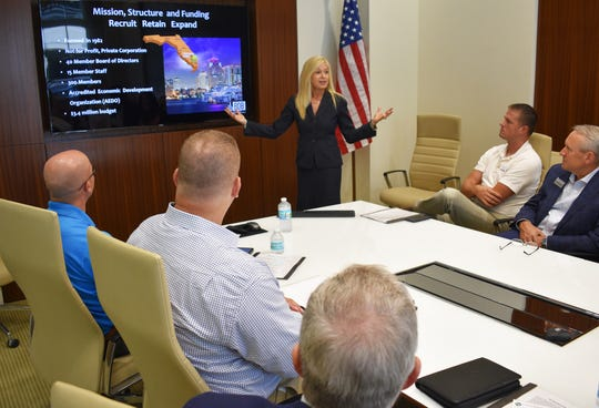 Kelly Smallridge, president and CEO of the Business Development Board of Palm Beach County, discusses Palm Beach County's business retention and attraction strategies with Collier County community leaders on Sept. 5 in West Palm Beach.