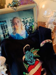 The T-shirt Kathy Messina wears to remember her daughter, in the frame photograph