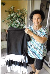 Catherine Sblendorio with her favorite dress of 40 years