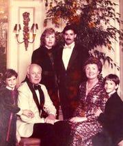 Sharon Cumming in her Oscar de la Renta dress in a family portrait