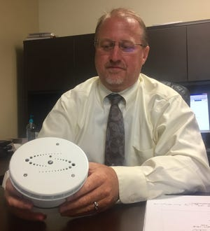 Southwest Licking Schools Superintendent Robert Jennell displays one of the eight new vaping detectors soon to be installed in the district's middle and high school restrooms.