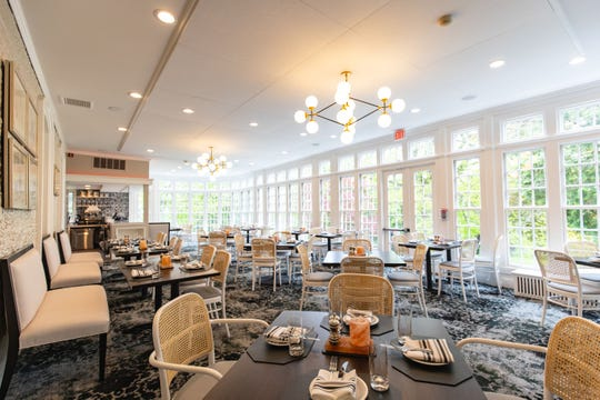 The new white dining room at David Burke at Orange Lawn
