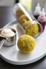 Edible dougnuts made to look like tennis ball at David Burke at Orange Lawn