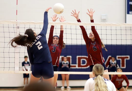 Lady 'Cats Kamryn Zachek (3) and Rachel Simpson (6) team for the block against Silver High's Lexy Ruiz.