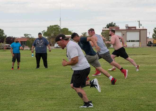 Otero County Bucks' football players sprint during practice, Sept. 8, 2019, on the Jim R. Griggs Sports Complex in Alamogordo, N.M. The team gathers every Sunday at 10 a.m. to practice.