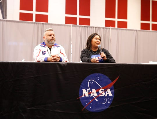NASA personnel Jeremiah O'Callahan, left, and Raquel Redhouse participate in a panel discussion at the NASA STEM Day on Sept. 12, 2019 at Navajo Technical University in Crownpoint.