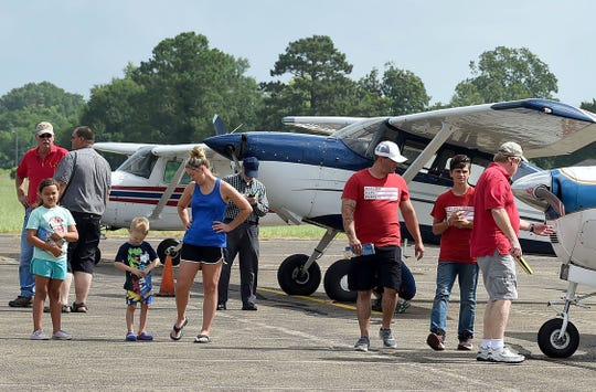 Visitors to the St. Landry Airport during a June airport-sponsored fly-in stroll past various aircraft that are on display. The airport which is hoping to achieve more economic stability, is hosting two public events over the next two months.