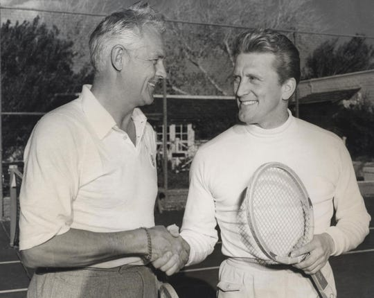 Charlie Farrell and Kirk Douglas after their morning tennis match at the Racquet Club.