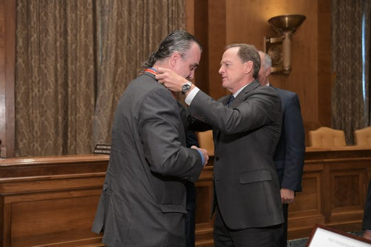Baltimore County Detective Roy Gibbs presented with the Congressional Badge of Bravery by Senator Pat Toomey (R-Pa.) on Sept. 12, 2019, in Washington, D.C.