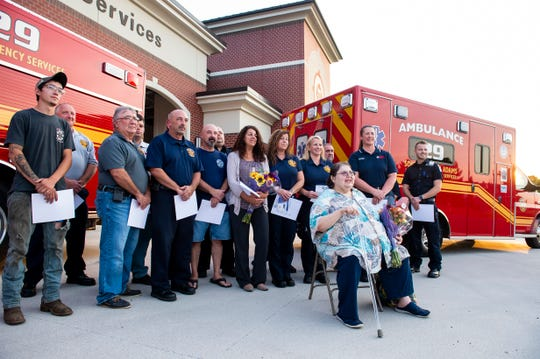 Karin Duff, front, poses for a photo with several first responders and one civilian who helped save her life on July 27, during a ceremony at S.A.V.E.S. in Conewago Township on Sept. 10, 2019.