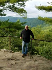 Tony Kastelic, of York, is seen on a camping trip at Cook Forest after being 11 months sober in 2017.