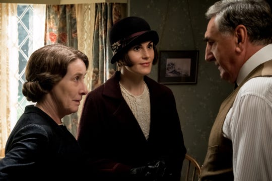 """Mrs. Hughes (Phyllis Logan, left), speaks with Lady Mary (Michelle Dockery) and Mr. Carson (Jim Carter) in """"Downton Abbey."""""""