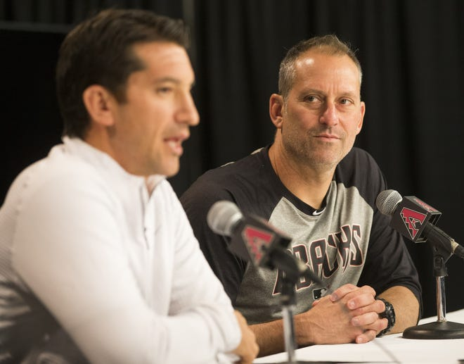 Arizona Diamondbacks general manager Mike Hazen (left) and manager Torey Lovullo talk to the media at Chase Field in 2017.