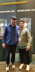 Higley's Marcus Edwards meets Aaron Rodgers in Green Bay on Friday.