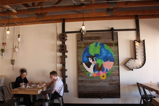 Diners enjoy vegan desserts at Earth Plant Based Cuisine, a Mexican eatery that opened on Grand Avenue.