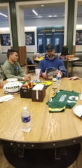 Higley's Marcus Edwards meets with Aaron Rodgers in Green Bay on Friday.