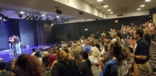 """The cast of """"Columbinus"""" hugs onstage to a standing ovation after the last of three performances at Greasepaint Youtheatre in Scottsdale."""