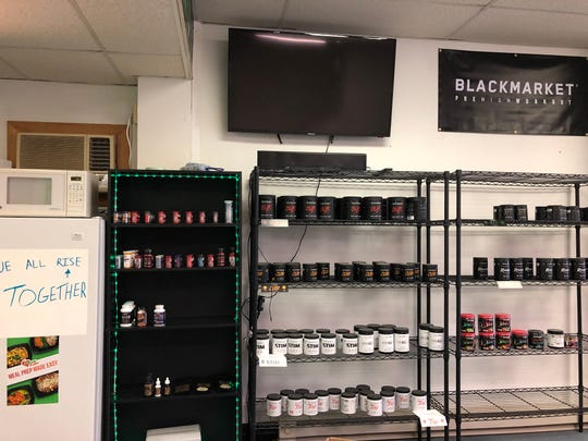 One wall inside the new Body Science Supplements has room for almost as much product as the entire previous location.