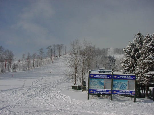 Two skiers have the bunny hill to themselves at Sugar Loaf ski resort in this 1999 photo. It closed in 2000.