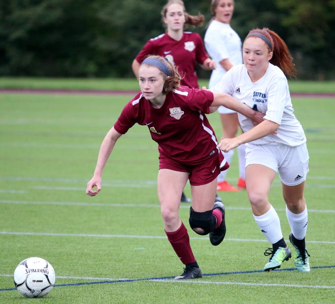 Arlington's Megan Stowell gets the ball away from Suffern's Alexis Farro during Thursday's game on September 12, 2019.