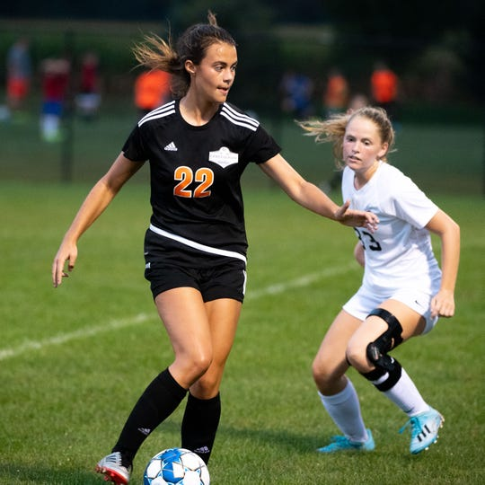 Chloe Carns (22) looks to get past the defense during the girls' soccer game between Central York and South Western at Central York High School, Thursday, September 12, 2019. The Panthers defeated the Mustangs 7-0.