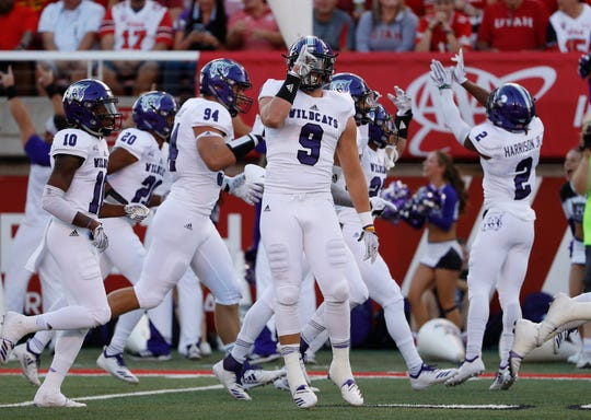 Weber State players celebrate an interception against Utah last season.
