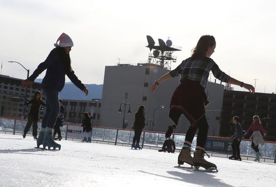 People skate at the Greater Nevada Field ice rink in Reno on Christmas Day, Dec. 25, 2017.