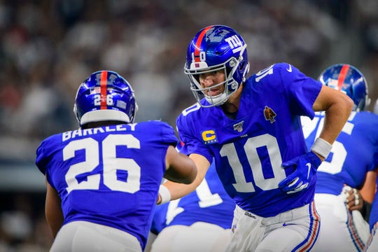 This might be the Giants offense: Eli Manning handing off to Saquon Barkley.