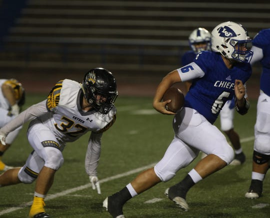 Albert Rodriguez, right, evades a tackle for Lake View during their game against Snyder on Thursday, September 12, 2019.