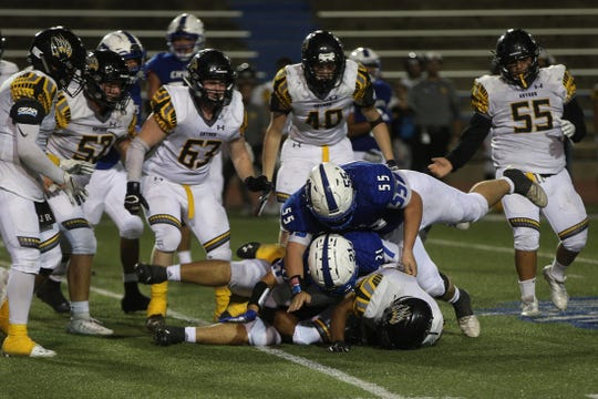 The Lake View defense smothers a Snyder player Thursday, September 12, 2019.