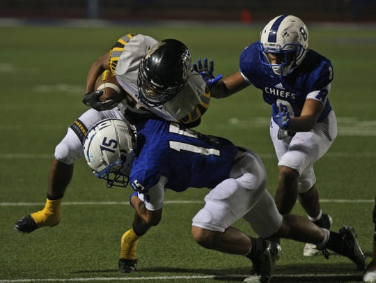 Johnny Espinosa, center, and Anthony Martinez, right, tackle a Snyder player for Lake View on Thursday, September 12,v 2019.