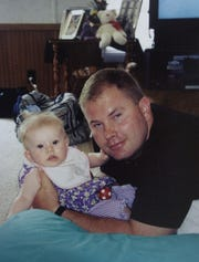 Gregory Guy Collins, 31, of Vienna is pictured with with his daughter Sydney Collins in this 2003 Daily Times file image.