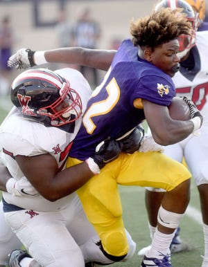 Byrd's Jeremy Williams loses his helmet on a run during Friday's meeting with West Monroe in the 2019 Landers Battle on the Border.