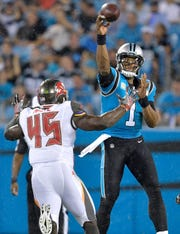 Cam Newton of the Carolina Panthers throws over  Devin White of the Tampa Bay Buccaneers during the first quarter of their game at Bank of America Stadium on Friday.