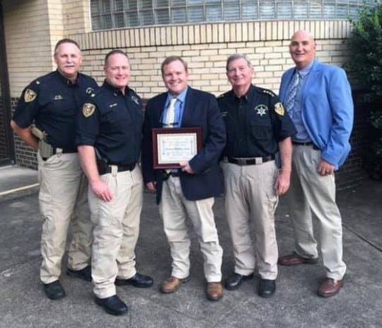 Chief Deputy Jay Long, Captain Bobby Herring, Cpl. Matt Lucky, Sheriff Steve Prator, Sgt. Jason Morgan.