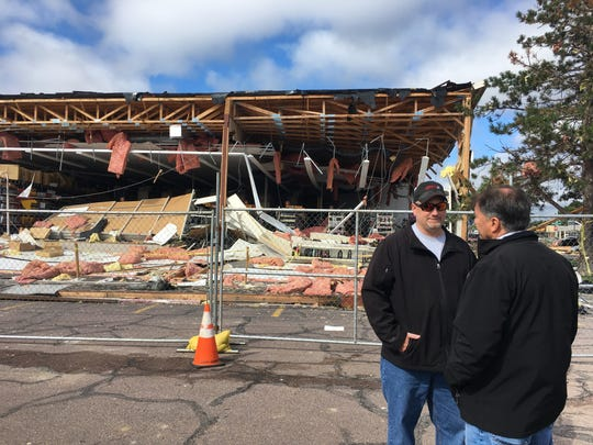 U.S. Sen. Mike Rounds speaks on Friday to Brett Wulff, general manager of Advanced Auto Parts, about the tornado damage at the building.